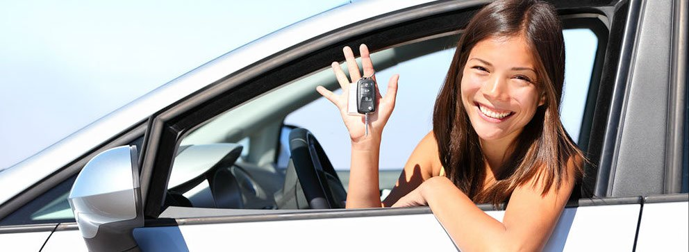 Girl In Car with keys - automotive locksmith