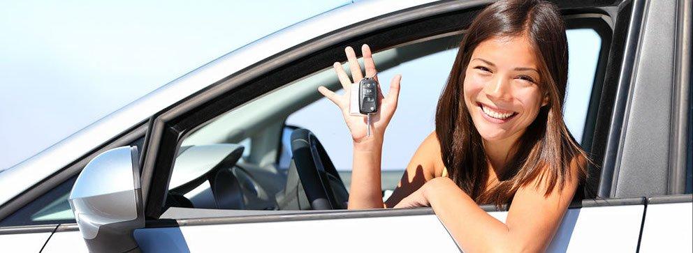 Girl In Car with keys - automotive locksmith